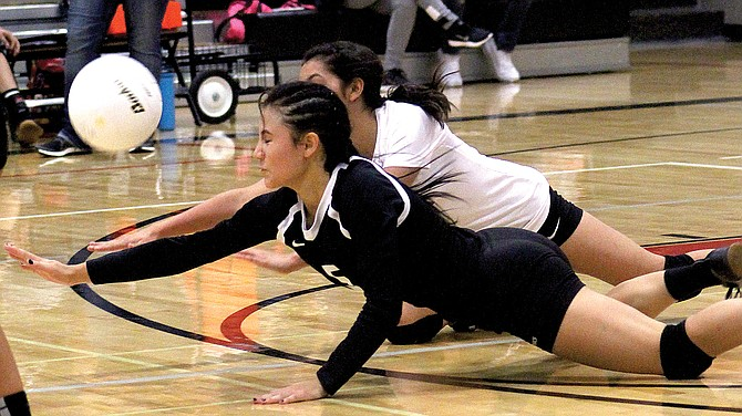 Sunnyside outside hitter Yadira Rivas, front, and libero Naila Rodriguez dive in an effort to prevent a Prosser point.