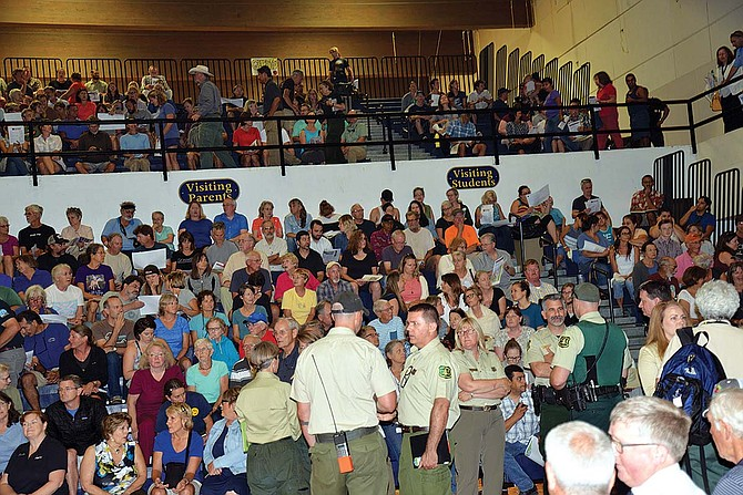"Fire Meeting: Hundreds packed the bleachers at Hood River Valley High School Thursday for an informational meeting on the Eagle Creek fire convened by the Unified Command. Speakers included Sheriff Matt English, Rep. Mark Johnson, and Lynn Burditt, U.S. Forest Service Area administrator, who said, ""We are in phase one of this fire. Let's prepare ourselves for what happens next and address the future of this part of the National Scenic Area."" (See hoodrivernews.com for further coverage.)"