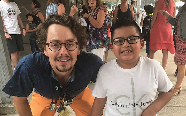 Cascade Locks Elementary teacher Derek Gries (4/5 teacher) and student Diego Ucan (4th grade) on Wednesday at Westside. Classes were moved to the Hood River school site due to the Eagle Creek fire and evacuations in Cascade Locks.