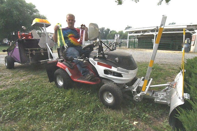 Matt West, Omak, shows off his lawn tractor and cart, which each won Special Awards at the Okanogan County Fair.
