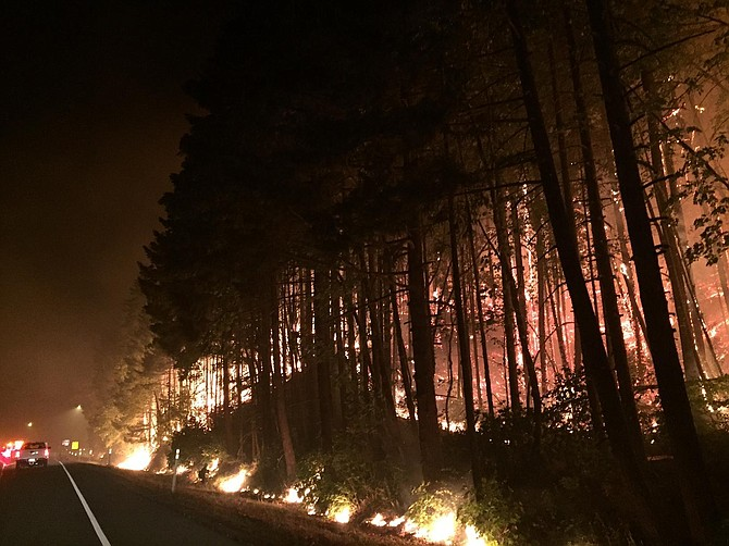 Fire crews back burned an area west of Cascade Locks, Ore., overnight to try to slow the growth of the Eagle Creek Fire. Interstate 84 remains closed in both directions between Hood River and Troutdale.