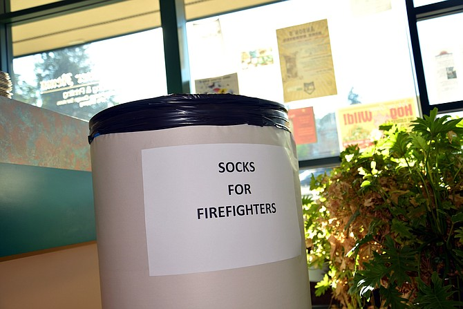 Hood River News is collecting socks to give to firefighters battling the Eagle Creek blaze.