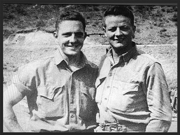 Jack Kightlinger, left, with friend Floyd Swift while serving in the U.S. Army.