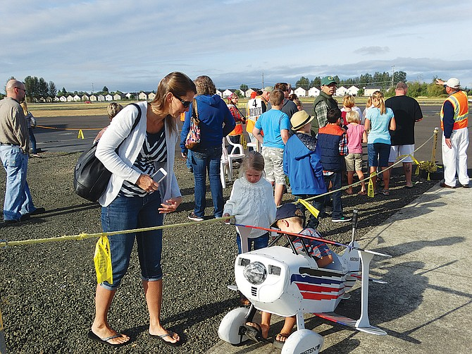 Ryan Timmons, 6, rides in a pedal-powered airplane while his older sister (not pictured) gets to take a free Young Eagles flight. Ryan's mom, Janice, said his sister has flown before, and it gives Ryan something to look forward to. The Young Eagles program is open to children aged 8 to 17, presented by the EAA Chapter 292.