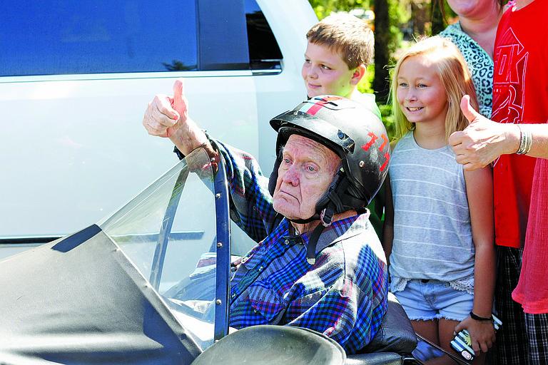 Bob Dunn gives a thumbs up before his ride.