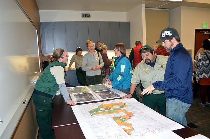 LEO SEGOVIA with Mt. Hood National Forest discusses an early map of the Polallie Cooper timber thinning and fuels reduction project area, at a public meeting in Hood River in early 2016.