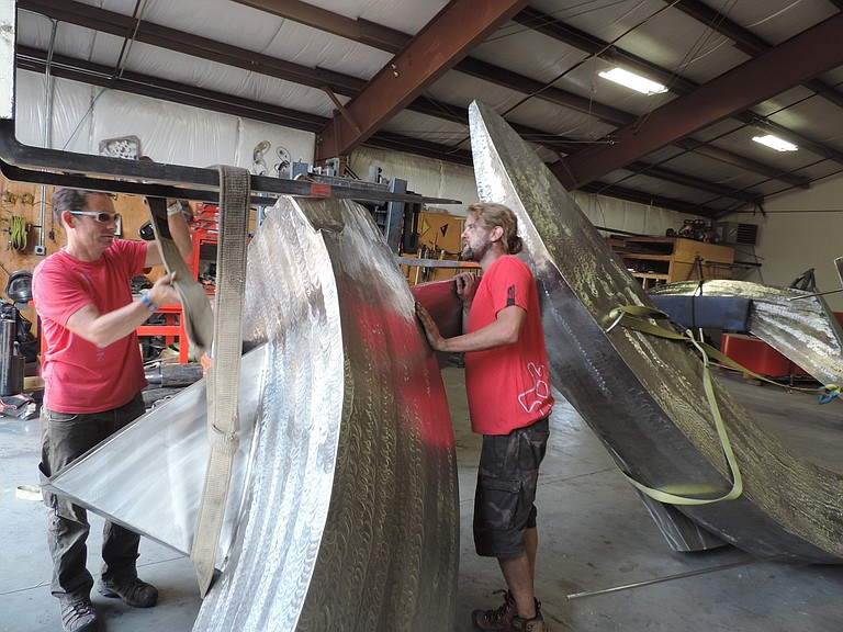 Just as Hurricane Irma bore down on the U.S. south Atlantic region on Friday, Hood River artist C.J. Rench, left, was preparing to send a massive sculpture to Jacksonville, Fla.