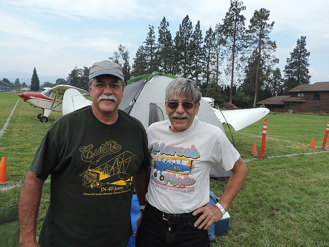 "CALIFORNIA pilots Frank Cortright, left, and Vernon Fueston drove to the fly-in and pitched their tents next to the WAAAM tow plane. They wanted to make sure they could see the flight of the 1917 ""Jenny."""