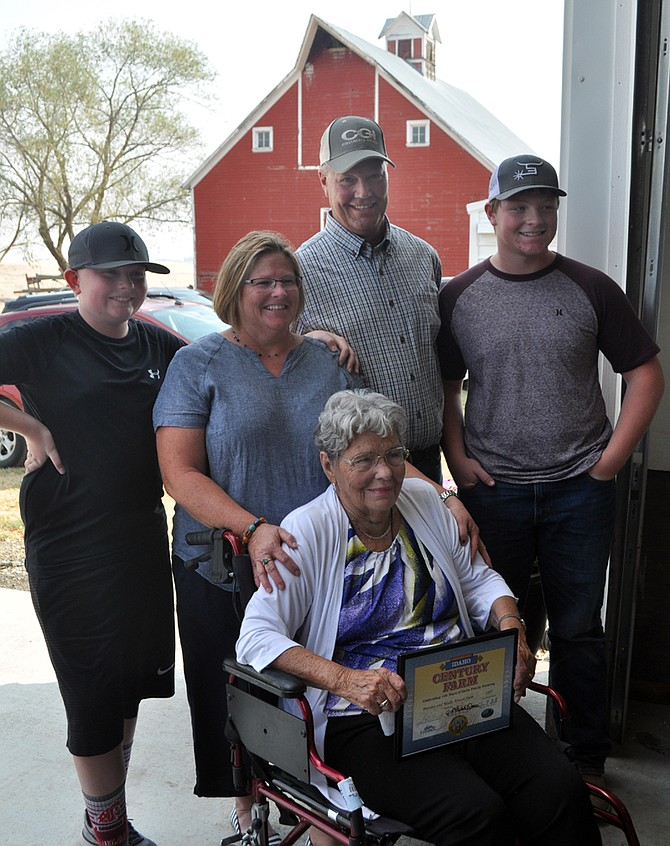 Pictured at Saturday's Century Farm ceremony are (L-R) Jeffrey, Mollie, Brendan and Dereck Arnzen; seated is Dorothy Schmidt.