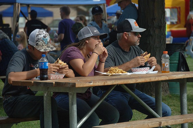 Fair goers stop for burgers and fries on Saturday afternoon.