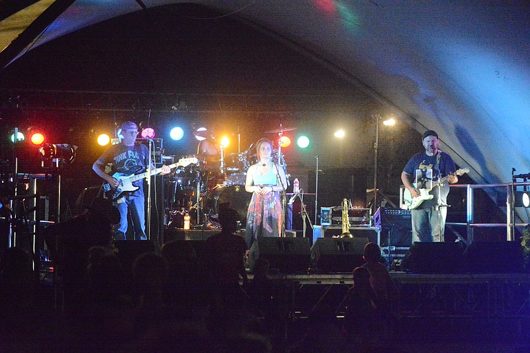 """The Company Band (comprised of Randy Statler, Kirk Gildroy, Angela Cross and Casey Martin) get the crowd dancing to a cover of Zac Brown Band's """"Chicken Fried."""""""