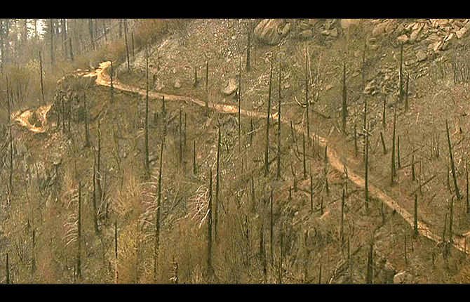 This image, taken from video provided by KGW-TV, shows fire damage to the area surrounding the Angel's Rest trail in the Columbia River Gorge near Cascade Locks. Authorities say trails affected by the wildfire in the Columbia River Gorge will likely be off-limits until spring because of landslide risk and fire damage.