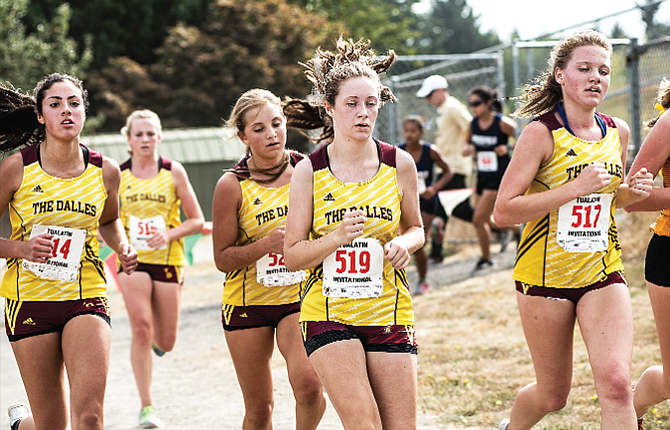 The Dalles cross country runners, pictured from left to right, Paulina Finn, Jenna Miller, Hanna Ziegenhagen, Tressa Wood, and Emma Mullins all put up solid opening times to lead the varsity girls to 134 points and fifth place. In all, TD set 26 personal records.