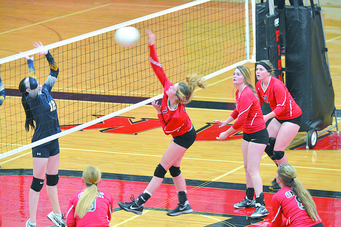 Kaitlyn Short (7) of Omak spikes against Oroville's Shantell McCune (12). Also for Omak are Shannon Fahey (8), Taylor George (11) and Allison Hale (11).