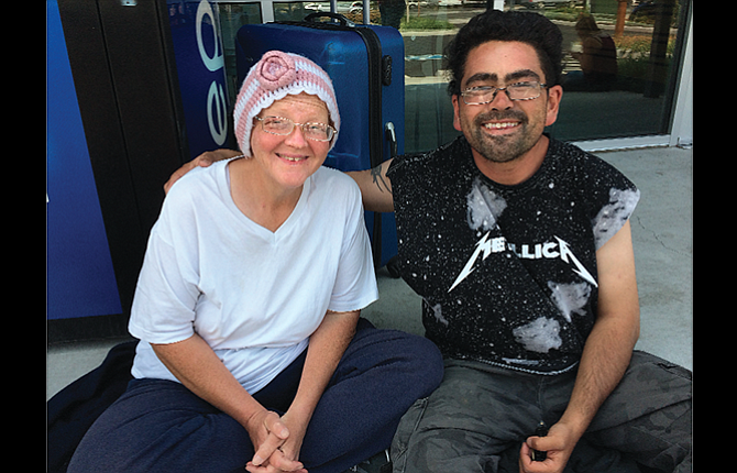 Christie Young, 48, and her husband Randall Young, 33, wait at The Dalles Transportation Center for a bus ride to Ontario. The couple are longtime homeless, and Christie has cancer and needs chemo treatments. She and her husband were sleeping behind a dumpster when a homeless advocate learned of their plight and got someone to donate bus tickets for them to Ontario, where they have contacts.
