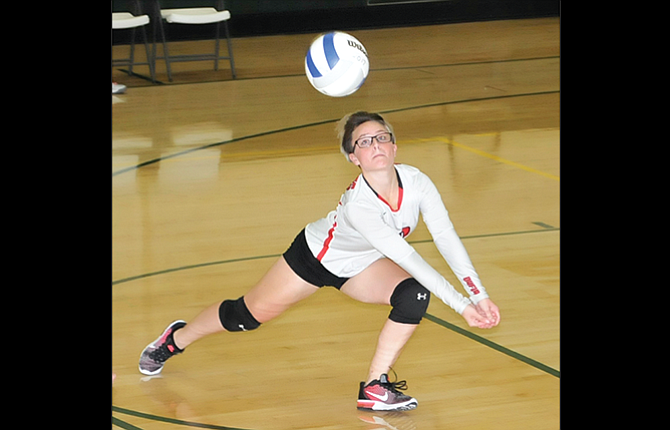 Dufur libero Aleksei Uhalde makes a diving dig in the fourth set of her team's match Tuesday in Maupin. The Lady Rangers fought with the Redsides for five sets, eventually losing by a 15-7 margin in the finale. Dufur won the second and fourth sets by an average of 4.5 points against the No. 9-ranked South Wasco County Redsides.