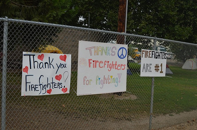 Signs thanking firefighters line the fence at the Hood River County Fairgrounds, which is serving as incident base for the Eagle Creek fire.