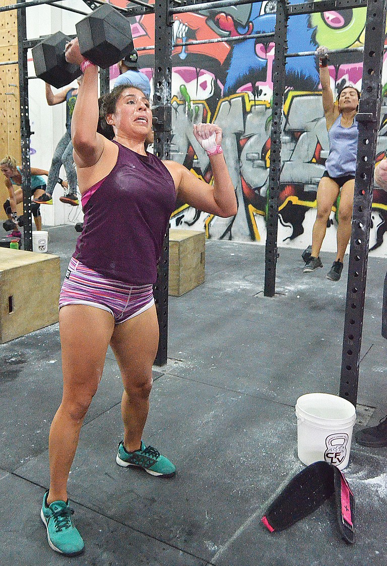 Celeste Olivian, a member of Crossfit Lower Valley, competes Saturday at her home gymnasium's Rally in the Valley. Results of the event were not available before presstime Monday.