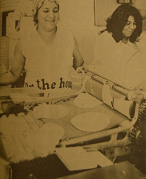 September. 15, 1977: After mixing the dough, Juana Dominguez and Cilia Mariscal are busy putting dough into a machine that cuts the mixture into perfect tortillas.