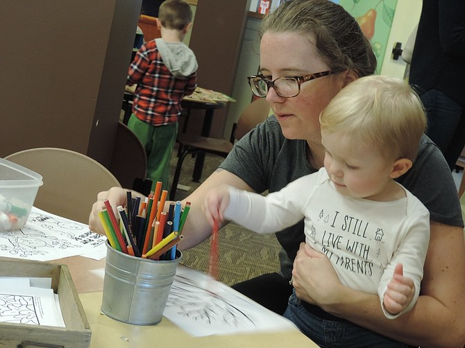 ASA May, 15 months, enjoys craft activities at Hood River Middle School with his mother, Erica, of Hood River.