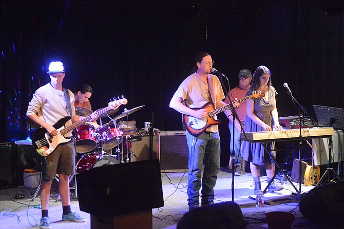 The Family Vibe - comprised of Tara Rickabaugh on keyboard, Forest Rickabaugh on bass, Fletcher Rickabaugh on drums and Josh Rickabaugh on guitar - performs original reggae music.
