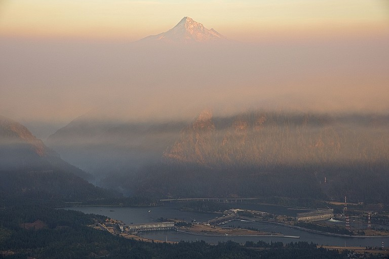 """OUT OF THE ASHES' — Peter Marbach went up Table Mountain for this Sept. 20 image of the pall created by Eagle Creek fire, over Bonneville Dam and the Eagle Creek basin. He writes about in """"The Daily Bread,"""" page B2."""