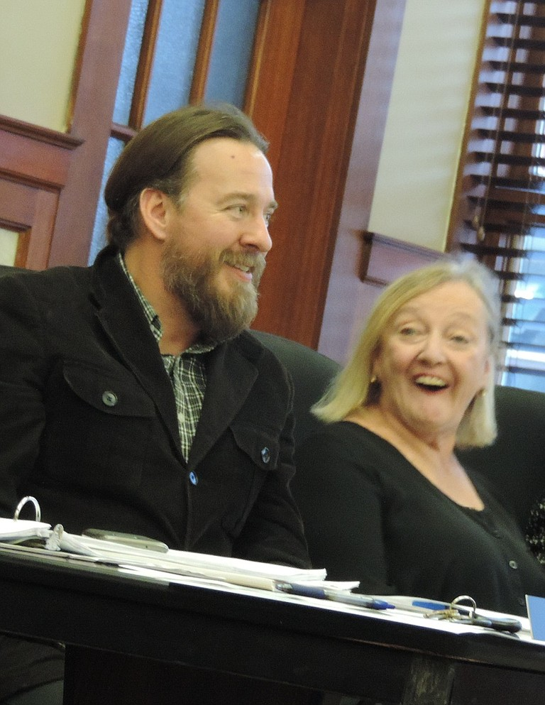 PLANNING Director Cindy Walbridge shares a laugh with her successor, Dustin Nilsen, Monday night.