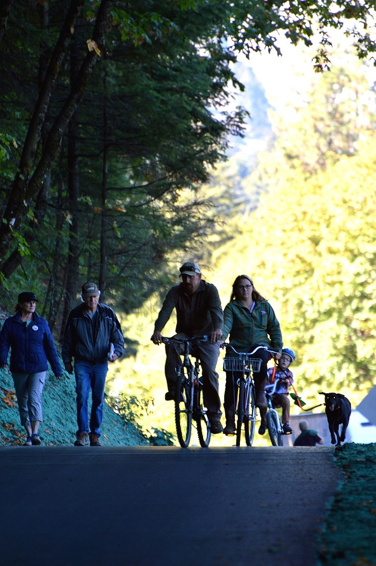 FAMILIES TRAVEL along the Columbia River Historic Highway State Trail near Starvation Creek State Park. A select few state-owned parks are reopening following closures caused by wildfires. Visitors should note the west portion of the trail remains closed.
