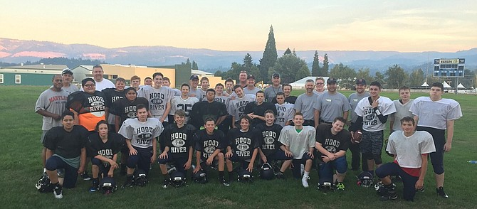 At practice on Sept. 12, the Hood River Valley 7/8 grade middle school football team had some visitors watching them work. Four firefighters from Albany, Tualatin Valley, Hood River and Medford enjoyed taking a break from fire camp to head next door to the Wy'east football field to check out the squad. One of the assistant coaches, Vince Wilson, from the Oregon Fire Marshal's office, had invited some fellow firefighters to check out the action. The boys were grateful to take a photo with these local celebrities on one of the few semi-clear nights seen since the fire started.