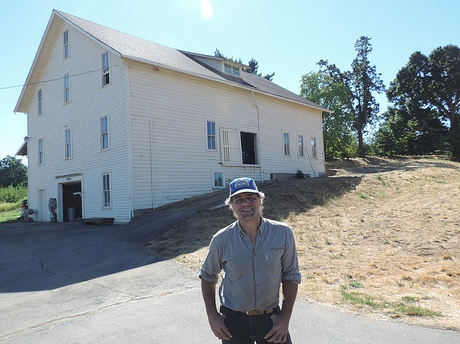 Chris Fairchild stands in front of the Fairchild packing house, on the east side of Highway 35 just south of Odell.