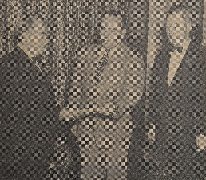 September 26, 1947 — Oscar F. Gardner, exalted ruler of Hood River Elks Lodge, tenders check for receipts from the Elks show in benefit of Hood River Hospital laboratory to Robert D. Barker, secretary-treasurer of the hospital board. Elk Arthur Johnsen (right) was in charge of the program presented at the Rialto Theater on September 16. The hospital lab fund benefitted by around $800. (Columbia Photo.)