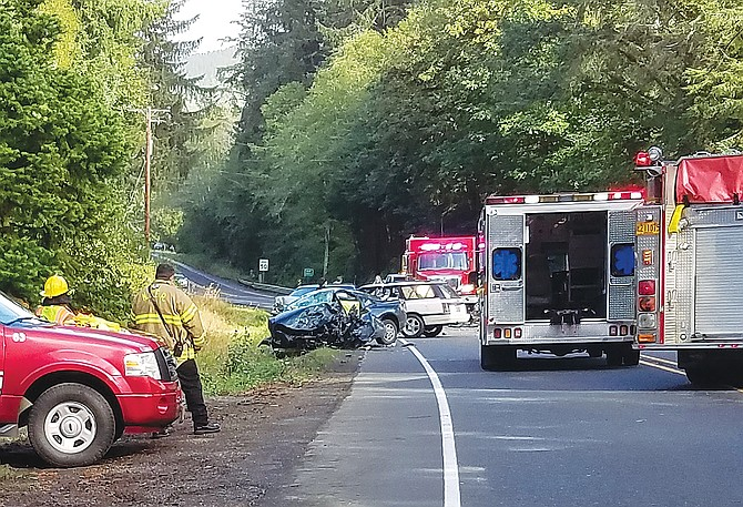 Grand Ronde residents were injured and one person died in a multi-car crash on Highway 18 near Otis on Sept. 19.