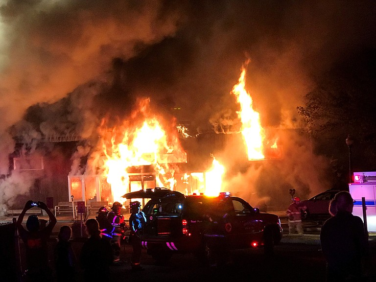 Photo by Bailey McManus  Flames engulf the Kayak Shed building, a total loss after Wednesday night's blaze.
