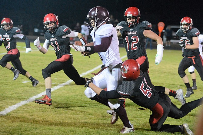 Kamiah's Kaleb Oatman accounted for essentially all the offense the Kubs produced Friday night, Sept. 30, at Prairie, where he was frequently surrounded by the Pirates defense.