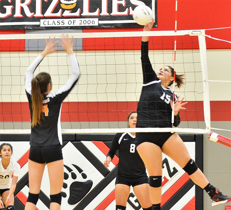 Miriam Galvan keeps the ball in play, forcing it over the net.