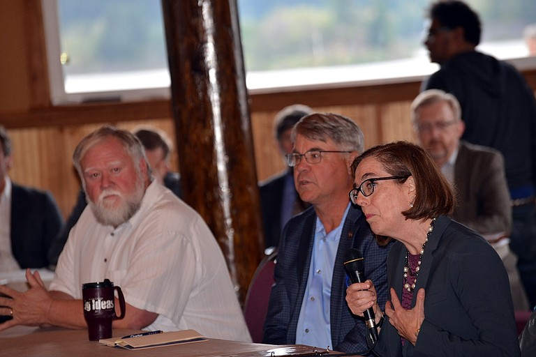GOV. KATE BROWN speaks at a Cascade Locks business listening session in response to the Eagle Creek fire. At left, Cascade Locks Mayor Tom Cramblett and Sen. Chuck Thomsen (R-Hood River).