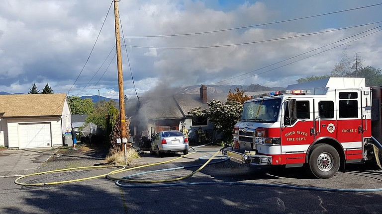 FIREFIGHTERS limited the fire to the garage and adjoining room in Saturday's fire.