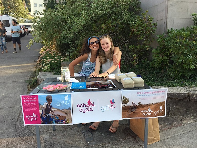 HRVHS Girl Up Club members Celia Acosta, left, and Eva Jones spread the word during a recent First Friday. The club is backed by the United Nations Foundation and is dedicated to actively working to empower adolescent girls from around the globe.