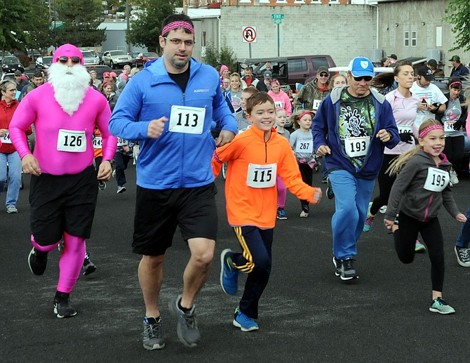 Despite some drizzle and cool temperatures, more than 100 people gathered for the annual Flamingo Fun Run Saturday, Sept. 30, during Grangeville's second annual Oktoberfest event. This year's run was organized by Grangeville High School senior Kate Lutz and proceeds will go toward helping find a cure for SMA (spinal muscular atrophy).