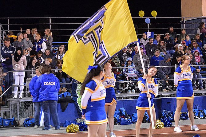 Tonasket High School cheerleaders wave a flag during game against Manson on Sept. 29.