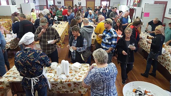 Dozens await fresh stew in the Conconully Community Hall.