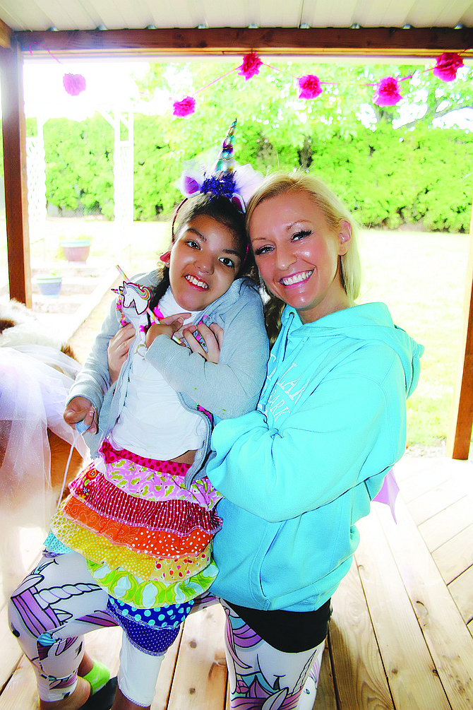 Elise, left, with her mom Audra Marsh at Elise's unicorn-themed 12th birthday party in June.