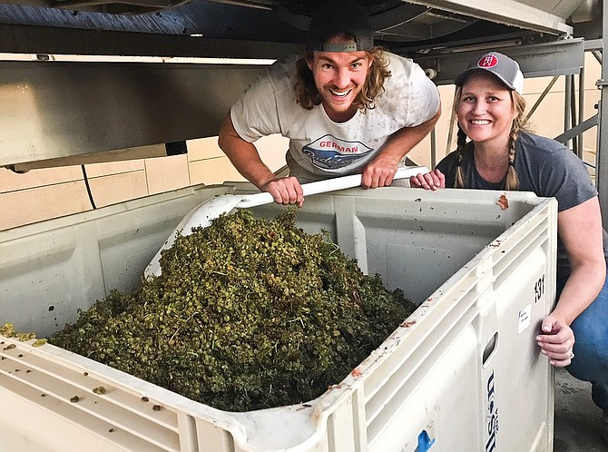 Fortuity Johnny Brose and co-owner Emily Christensen do some of the hard work associated with wine making.