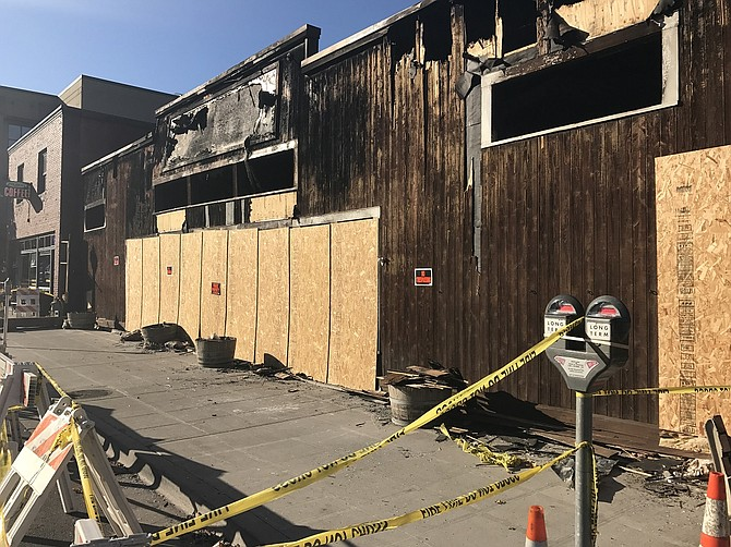 PLYWOOD covers the windows, doors and other openings at the remains of the Kayak Shed. The building is unsafe and should not be entered.