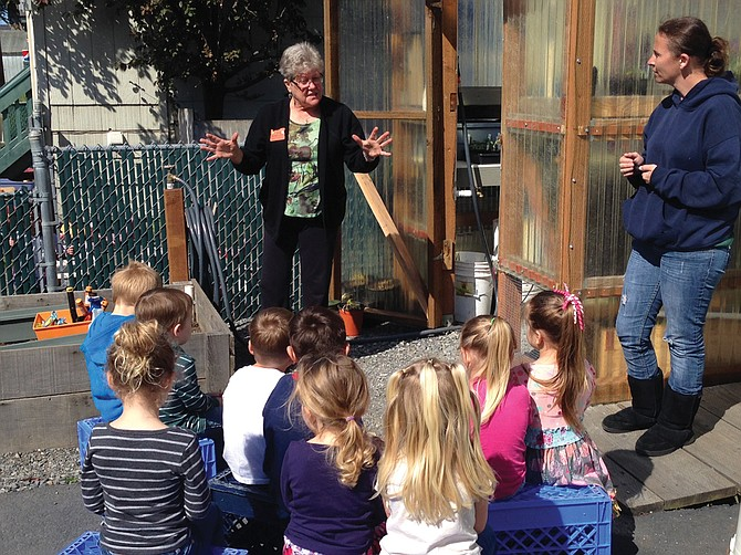 Barb Cary fulfills her volunteer hours as an OSU Extension Master Gardener by teaching preschool children about gardening.