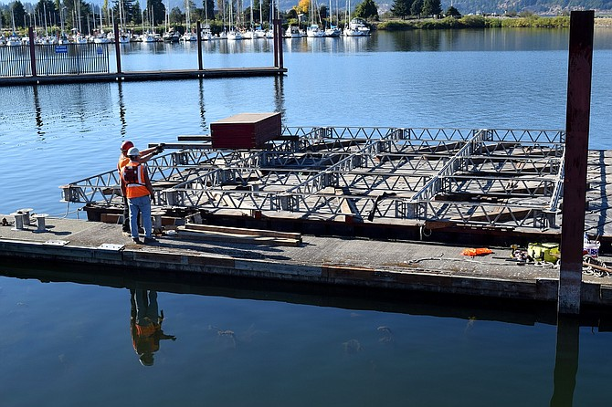 CREWS with Abhe and Svoboda, Inc. assemble a platform at the Hood River Marina, for use at the Hood River Bridge, where workers will be doing maintenance well into the month. Some closures have been lifted.