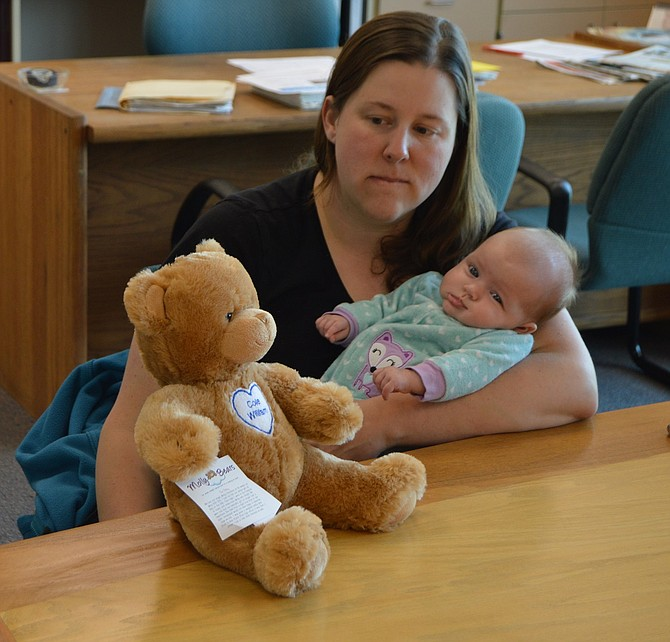 """EVERLY Bolger, three months, """"will always know she has a brother,"""" Cori Bolger said, with the help of photos and a commemorative Molly Bear stuffy, which weighs 3.5 pounds, Cole's birth weight (mollybears.org)."""