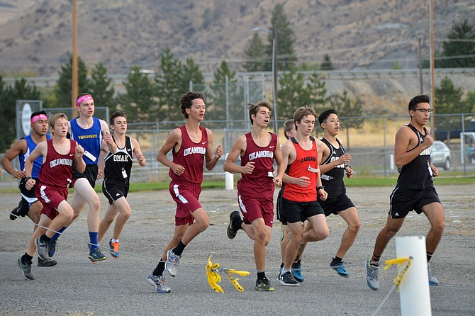 Runners near the front of the pack early in the 5K race at the Omak Invitational on Oct. 4.