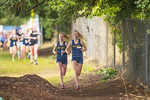 The girls team was led by the Dickinson sisters. (Right) Josephine and (Left) Frances Dickinson finished in first and third place, respectively this past weekend. Josephine's first-place finish (19:20.80) was her first XC high school varsity victory.