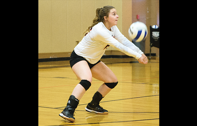 Sherman Husky libero Shelby Reed volleys a pass to a teammate in a varsity match in Moro. Friday in Condon, the Huskies picked up a sweep to move into fourth place in the Big Sky standings.